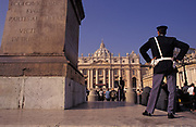 Two police officers keep watch over tourists in the centre outside the Vatican in St. Peter's Square, on 3rd November 1999, in Rome Italy.