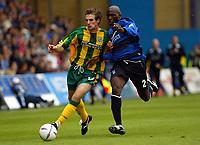 Photograph:Scott Heavey.<br />Gillingham v West Bromwich Albion. Nationwide Duvision one. 04/10/2003.<br />Scott Dobie (Left) of WBA battles with Ian Cox