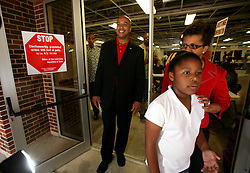 April 22nd, 2006. New Orleans, Louisiana. Voting day. Ray Nagin with his wife and daughter at Jesuit High School in mid city.<br /> Photo; Charlie Varley/varleypix.com