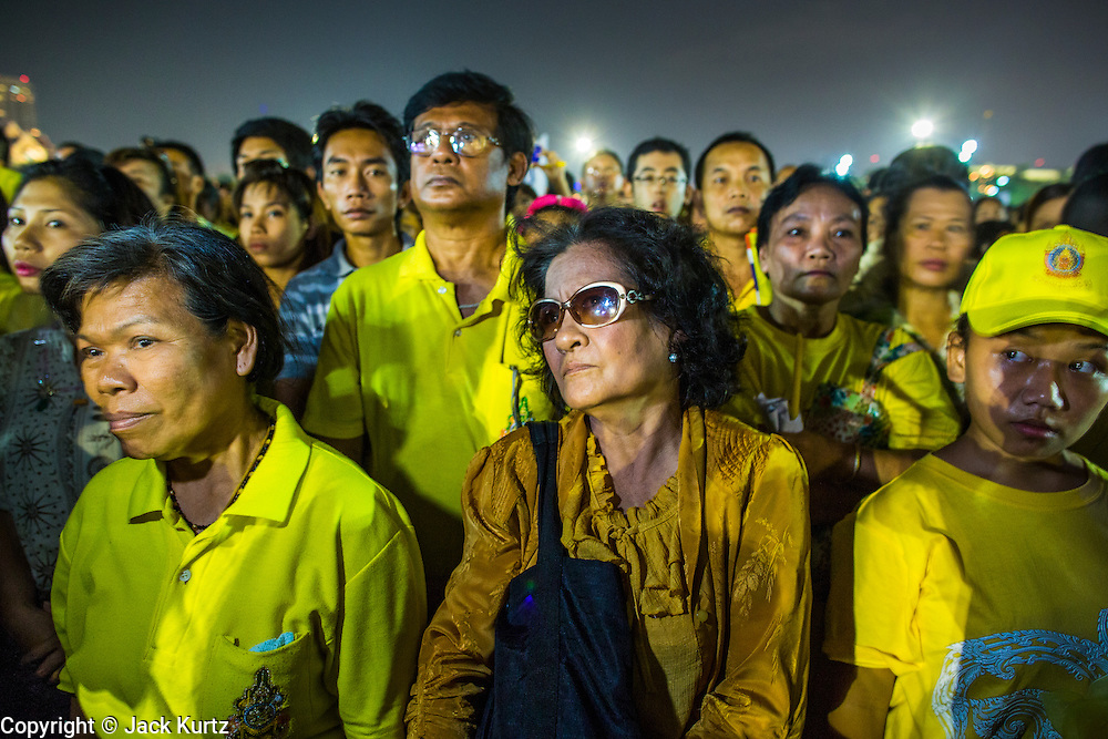 05 DECEMBER 2012 - BANGKOK, THAILAND: Thais gather at Sanam Luang for a candle light vigil during the public ceremony to celebrate the birthday of Bhumibol Adulyadej, the King of Thailand, on Sanam Luang, a vast public space in front of the Grand Palace in Bangkok Wednesday night. The King celebrated his 85th birthday Wednesday and hundreds of thousands of Thais attended the day long celebration around the Grand Palace and the Royal Plaza, north of the Palace. The Thai monarch is revered by most Thais as unifying force in Thailand's society, which is not yet recovered from the political violence of 2010.      PHOTO BY JACK KURTZ