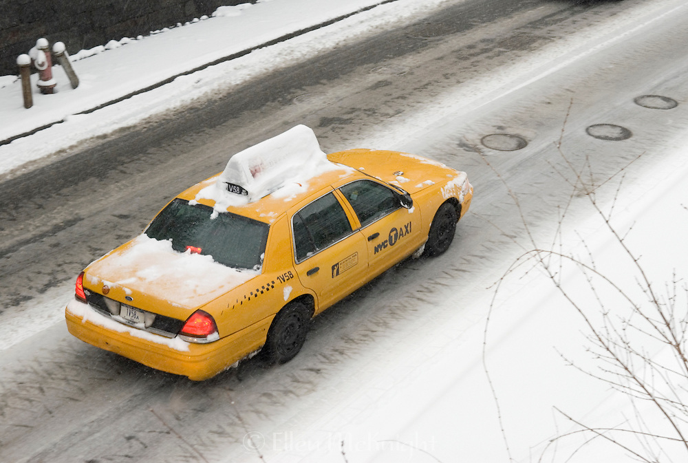 Taxi Driving Through Central Park, NYC During a Snowstorm