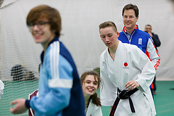 © Licensed to London News Pictures. 25/03/2015. LONDON, UK. Deputy Prime Minister Nick Clegg exercising with school children as he launches a charter to tackle mental health discrimination in sports at Oval Cricket Ground in London on Wednesday, 25 March 2015. Rugby Football Union, English Cricket Board and the Football Association, have all committed to sign the charter committing to removing the stigma and prejudice around mental health from the world of sport. Photo credit : Tolga Akmen/LNP