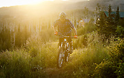 SHOT 8/5/17 6:03:26 AM - Nick Jones of Cedar City, Utah climbs one of the trails at the Mountain Bike Park at Brian Head Resort early one morning. With its combined chairlift and shuttle service Brian Head gives riders access to more than 100 miles of the most scenic and exhilarating mountain bike trails in the country. (Photo by Marc Piscotty / © 2017)