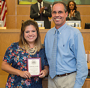 Robert Gasparello, right, presents the Houston ISD Employee of the Month Award to Maritere Ugalde, left, during a Board of Trustees meeting, September 10, 2015.