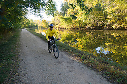 Washington DC; USA: Fall color in Washington DC, as seen by a bicyclist along the C&O Canal..Photo copyright Lee Foster Photo # 31-washdc75606