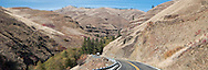 A vehicle pulling a trailer descends  Rattlesnake Grade to the Grande Ronde River Canyon, Asotin County, WA, USA panorama