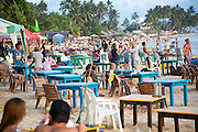 Crowded view of people and tables of beach bar, Mirissa, Sri Lanka, Asia