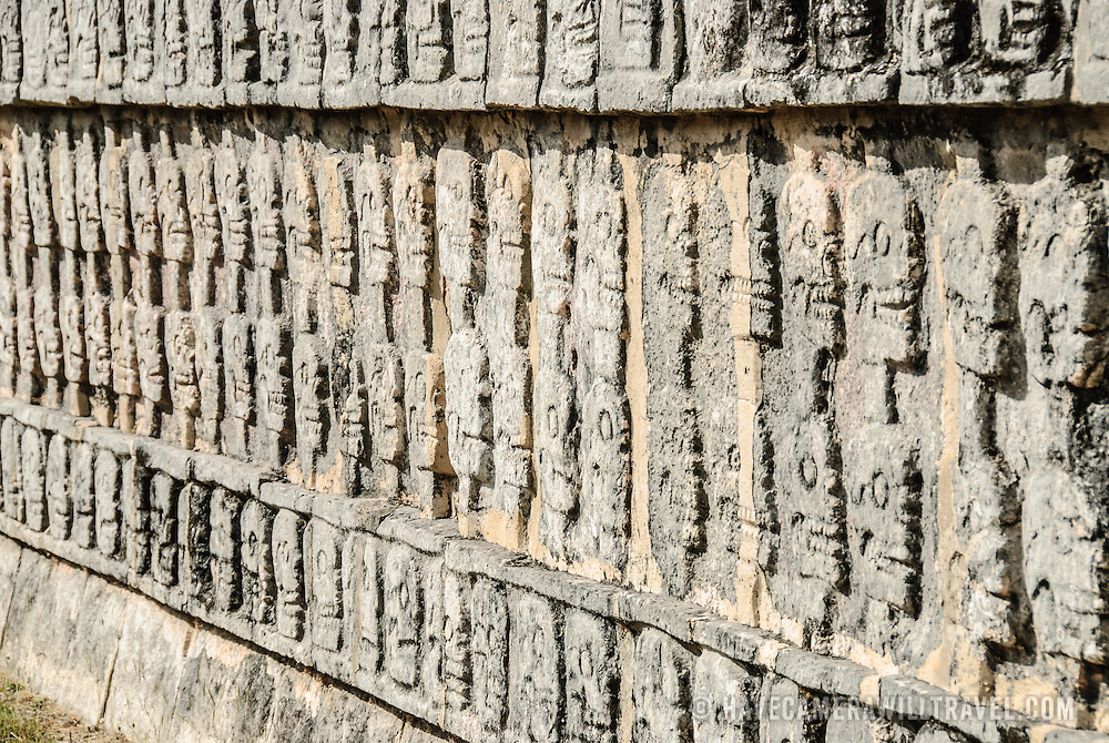 Depiction of skulls carved in a stone wall at Chichen Itza, Mexico.