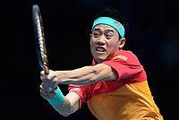 Tennis - 2018 Nitto ATP Finals at The O2 - Day Five<br /> <br /> Group Singles Group Lleyton Hewitt: Dominic Thiem (AUT) vs. Kei Nishikori (JPN)<br /> <br /> Nishikori launches into a backhand.<br /> <br /> COLORSPORT/ASHLEY WESTERN