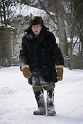 Malishevo, Russia, 29/02/2004.&#xD;An old man struggles uphill to the village centre during a snow blizzard.<br />
