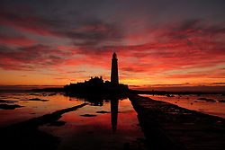The sun rises at St. Mary's Lighthouse, Whitley Bay.