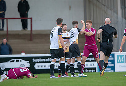 Arbroath's Jason Thomson and Dumbarton's Brad Spencer such each other after Arbroath's Omar Kader tackled by Spencer. Arbroath 3 v 1 Dumbarton, Scottish Football League Division One played 20/10/2018 at Arbroath's home ground, Gayfield Park.