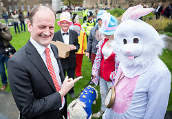 © Licensed to London News Pictures. 29/03/2017. London, UK. Douglas Carswell speaks to a group dressed in Alice in Wonderland fancy dress themed on College Green. British Prime Minister Theresa May has signed a letter to trigger Article 50 today. Photo credit : Tom Nicholson/LNP