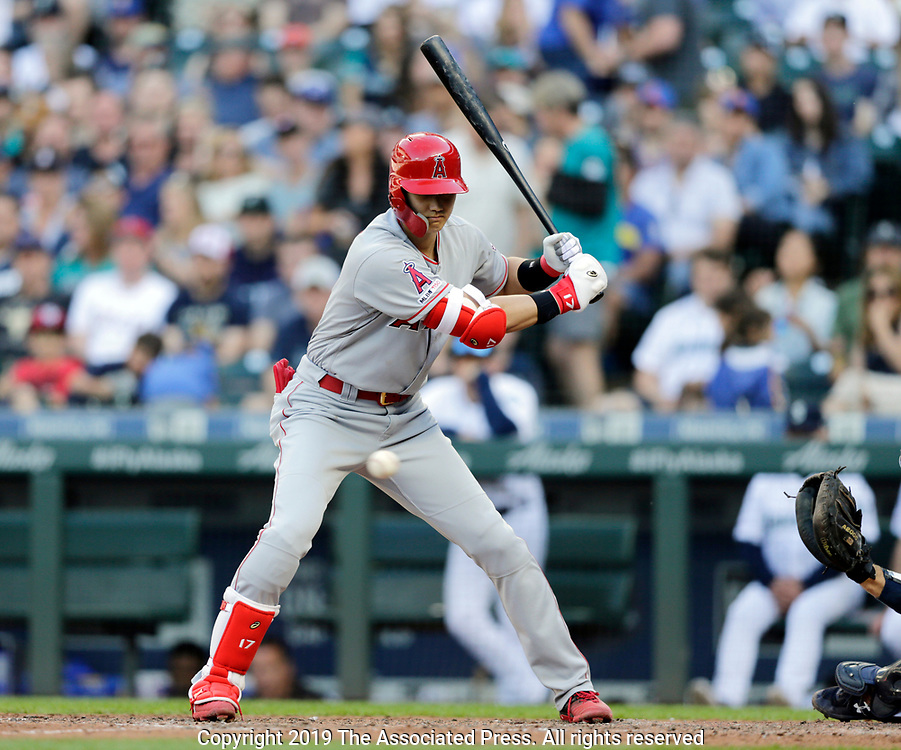 Los Angeles Angels' Shohei Ohtani watches a pitch while batting against the Seattle Mariners during a baseball game, Saturday, June 1, 2019, in Seattle. (AP Photo/John Froschauer)