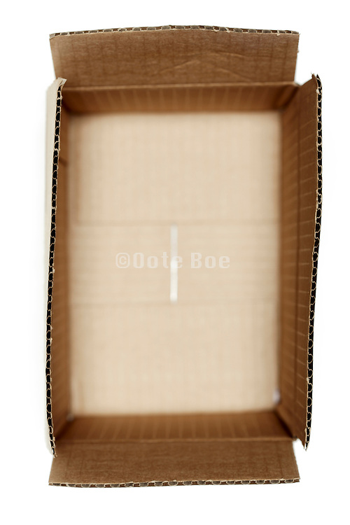 still life of an opened carton box with a small dept of field