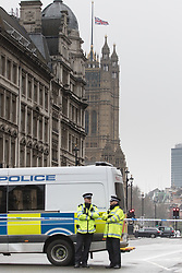 Scotland Yard, London, March 23rd 2017. The flag on Victoria Tower flies at half mast and police man a cordon on Whitehall following Tuesday's terrorist attack on Westminster Bridge and in the grounds of Parliament, in which four people and their attacker were killed with over 40 injured.