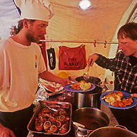 A cook (Michael Holmes) serves dinner in the dining tent at Adventure Network's Patriot Hills expediton base, the first private aviation hub in Antarctica.