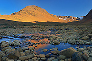 Last light on the Tablelands (Earth's mantle)  made up of Peridotite which is high in iron<br />Gros Morne National Park<br />Newfoundland & Labrador<br />Canada