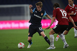 FootballL: Europa League, Qualification, Hannover 96 - St. Patricks Athletic, Hannover, 09.08.2012..Chris Forrester (St. Patricks, l.) - Christian Schulz (Hannover)..©pixathlon