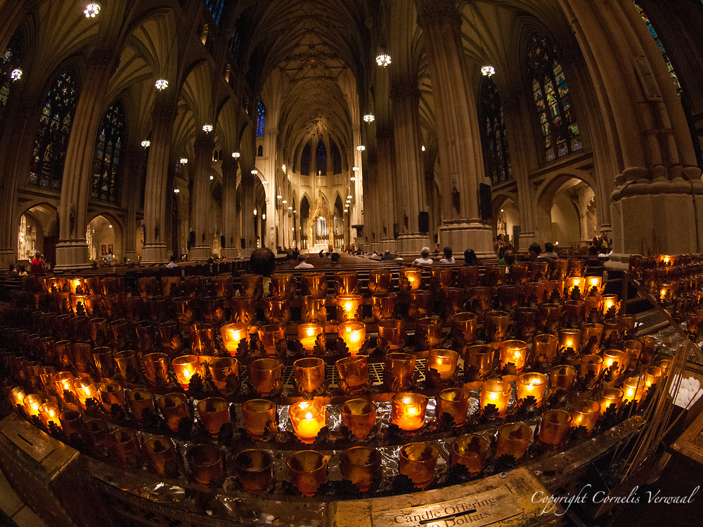 The glow of votive candles in St. Patrick's Cathedral, New York City.