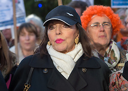 © Licensed to London News Pictures.  25/11/2017; Bristol, UK. Dame JOAN COLLINS with women's group The Soroptomists on Bristol's College Green at a rally against domestic violence and to campaign for healthy relationships. Under the banner 'Railing Against Abuse', members of the group travelled to Bristol by train on Saturday, November 25, before walking to College Green where they handed out leaflets entitled Loves Me, Loves Me Not in the shape of bookmarks and cards which offer a simple message about abusive relationships and a helpline for anyone who needs support. They were joined at College Green by Dame Joan Collins and her daughter Tara Newley Arkle, Lord Mayor Lesley Alexander, and Avon & Somerset Police and Crime Commissioner Sue Mountstevens. The march marks the United Nations' Elimination of Violence Against Women Day. Picture credit: Simon Chapman/LNP