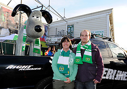 Fans pose outside with the Yeovil Town FC gromit outside Huish Park on Sunday 10th October - Photo mandatory by-line: Dougie Allward/JMP - Tel: Mobile: 07966 386802 10/11/2013 - SPORT - FOOTBALL - Huish Park - Yeovil - Yeovil Town v Wigan Athletic - Sky Bet Championship