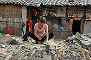 China, Female builder fitting bricks
