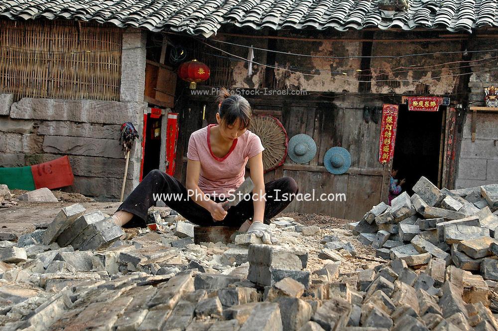 China, Female builder fitting bricks
