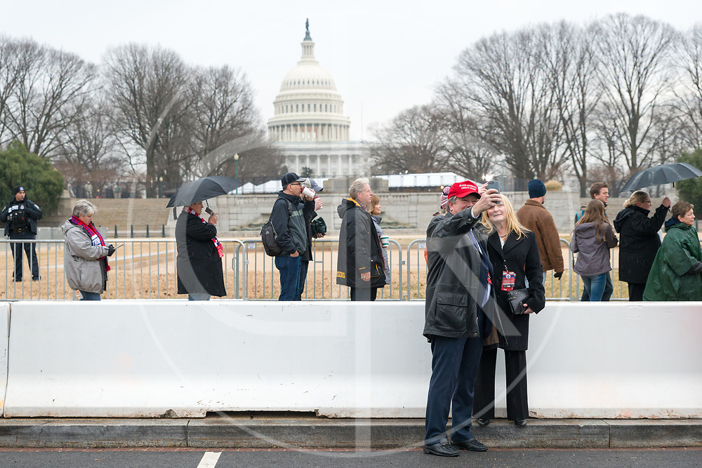 Washington DC, United States - Two Trump supporters snap a selfie in front of the U.S. Capitol on Inauguration Day, 2017.
