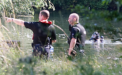 © licensed to London News Pictures. 15/07/2011. Maidenhead, UK. Police divers from a search and rescue team searching Cookham Lock near Maidenhead, Berkshire today (15/07/2011) where 59 year-old Michael Payne went into the river trying to save his teenage daughter Zoe. Zoe was pulled to safety, but Mr Payne dissapeared beneath the surface , watched by his partner and two daughters. Photo credit should read Ben Cawthra/LNP