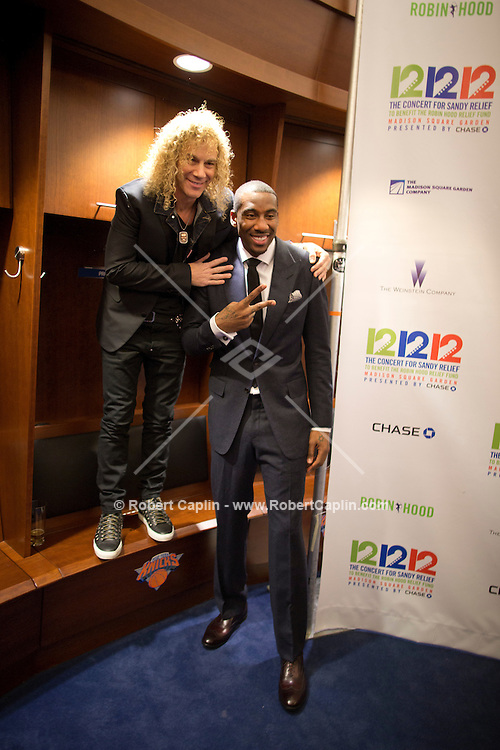 """Amare Stoudemire and David Bryan of Bon Jovi at a meet-and-greet in the Knicks lockeroom. """"12-12-12?, a fundraising concert to aid the victims of Hurricane Sandy, will take place on December 12, 2012 at Madison Square Garden. The concert featured The Rolling Stones, Bon Jovi, Eric Clapton, Dave Grohl, Billy Joel, Alicia Keys, Chris Martin, Bruce Springsteen & the E Street Band, Eddie Vedder, Roger Waters, Kanye West, The Who, and Paul McCartney. All the proceeds went go to the Robin Hood Relief Fund. Robin Hood, the largest independent poverty fighting organization in the New York area, will insure that every cent raised will go to non-profit groups that are helping the tens of thousands.of people throughout the tri-state area who have been affected by Hurricane Sandy...Photo © Robert Caplin.."""