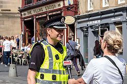 Pictured: Chief Inspector Murray Starkey<br />Summer City is Edinburgh Division's annual campaign to keep the public safe during the Edinburgh Festival.<br /><br />Chief Inspector Murray Starkey was joined by Police Sergent Janie Harman and PC Greig Stephen as they engaged with the public.<br />Ger Harley | EEm 10 July 2019