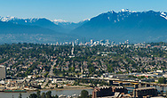 View of the Vancouver city skyline against a hazy backdrop of mountains in British Columbia, Canada