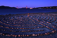 The Lands End labyrinth at dusk with the lit Golden Gate Bridge in the background - San Francisco, California