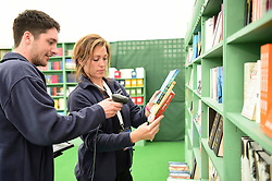 © London News Pictures. 26/05/2016. Hay on Wye, UK. The opening day of the Hay Festival 2016, and members of staff are busy stocking the shelves with books in  the bookshop  on the festival site. Photo credit: Keith Morris/LNP