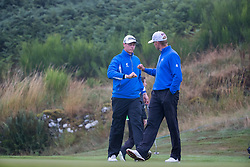 Iceland's Birgir Hafthorsson fist pumps his playing partner Axel Boasson after a par save on the 7th hole the 7th during his semi final match with Spain during day eleven of the 2018 European Championships at Gleneagles PGA Centenary Course.