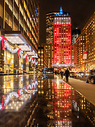 The Helmsley Building lit up in orange and blue color in Manhattan, New York City.