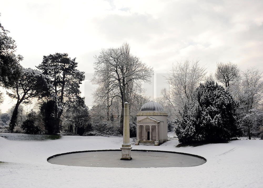 © Licensed to London News Pictures. 10/02/2012, London, UK. The Iconic Temple and Mirror Lake. People enjoy the snow in the grounds of Chiswick House in West London today 10 February 2012. Chiswick House, undergoing restoration,  is the first and one of the finest examples of neo-Palladian design in England.  Inspired by the architecture of ancient Rome and 16th Century Italy, the third Earl of Burlington built the house as a homage to Renaissance architect Palladio.The cold weather across the UK is set to continue over the weekend.  Photo credit : Stephen Simpson/LNP