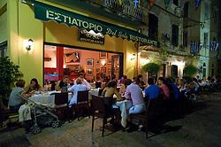 Restaurants at night on Guildford street in old town of Kerkya on Corfu Island in Greece