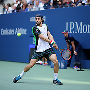 2016 U.S. Open - Day 6  Paolo Lorenzi of Italy in action against Andy Murray of Great Britain in the Men's Singles round three match on Arthur Ashe Stadium on day six of the 2016 US Open Tennis Tournament at the USTA Billie Jean King National Tennis Center on September 3, 2016 in Flushing, Queens, New York City.  (Photo by Tim Clayton/Corbis via Getty Images)