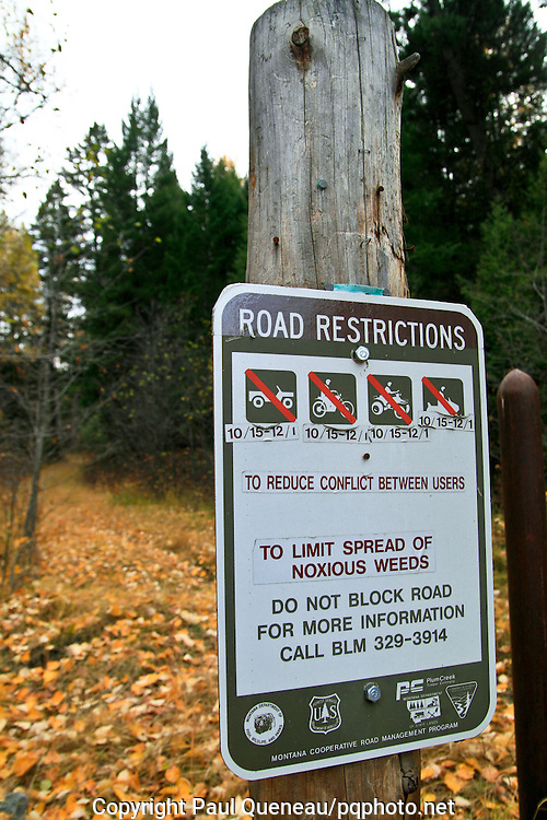 A sign lays out for hunters and other recreationists what vehicles they may use to access national forest in Montana's Blackfoot Valley.