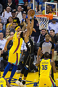 Golden State Warriors center JaVale McGee (1) attempts to block a Milwaukee Bucks shot at Oracle Arena in Oakland, Calif., on March 29, 2018. (Stan Olszewski/Special to S.F. Examiner)