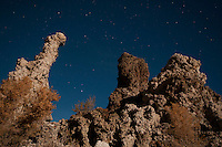 Tufa towers in moonlight at the South Tufa Area, Mono Lake Tufa State Natural Reserve, Mono Lake, California. Tufa is formed when springs under the lake mix calcium-rich freshwater with alkaline lakewater, precipitating deposits of calcium carbonate. The lake level has dropped more than 30 feet since 1941, when the city of Los Angeles began diverting water from the streams that feed it, exposing the formerly submerged tufa.
