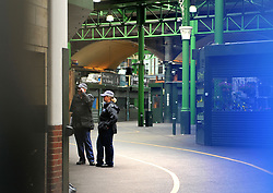 NOTE: THIS HAS BEEN PHOTOGRAPHED THROUGH A HOLE IN A TARPAULIN Police inside Borough Market following the terror attack in which eight people died.
