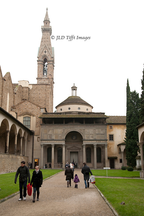 """Brunilleschi's next major work after the Ospedale degli Innocenti was the Pazzi Chapel, next to the Santa Croce basilica, from 1441-1460.  The Pazzi family, rich Florentine bankers, conspired against the Medici brothers Lorenzo and Giuliani. In 1478 they succeeded in murdering Giuliano during mass in the cathedral.  Lorenzo escaped and became subsequently """"Lorenzo the Magnificent.""""  The Pazzi chapel, however, is a gem of serene beauty.  This exterior shot is the usual one shown in books.  A few tourists come and go on the approach path."""