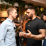 Kieran from Love Island & Charlie Thuillier - Founder of Oppo attend the Oppo party to launch its new Madagascan Vanilla, Sicilian Lemon and Raspberry Cheesecakes, served with Skinny Prosecco at Farm Girls Café, 1 Carnaby Street, Soho, London, UK on July 18 2018.