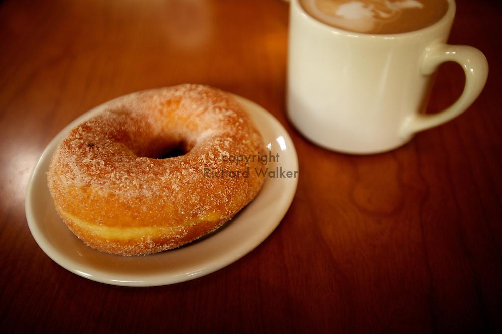 2010 October 27 -  Sugar ring cake doughnut and espresso coffee drink in a mug at Top Pot Doughnuts, Capitol Hill, Seattle, WA. CREDIT: Richard Walker