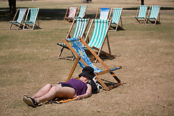 © licensed to London News Pictures. London, UK 17/07/2013. People enjoying the sunshine and hot weather in St James's Park, London on Wednesday, 17 July 2013. Photo credit: Tolga Akmen/LNP