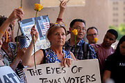 Demonstrators listen to speakers during the Families Belong Together protest in front of Dallas City Hall in downtown Dallas. The protest is part of a national effort to bring attentipon to the Trump administration's separation of children from their parents at the US/Mexico border and housing them in a tent city in Tornillo Tx, close to El Paso.