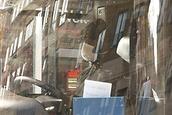 © Licensed to London News Pictures. 17/03/2020. London, UK. A bus driver wearing a face mask. London Transport will reduce weekday services during the coronavirus crisis to a weekend level of service. Photo credit: Dinendra Haria/LNP